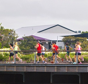 runners going over bridge