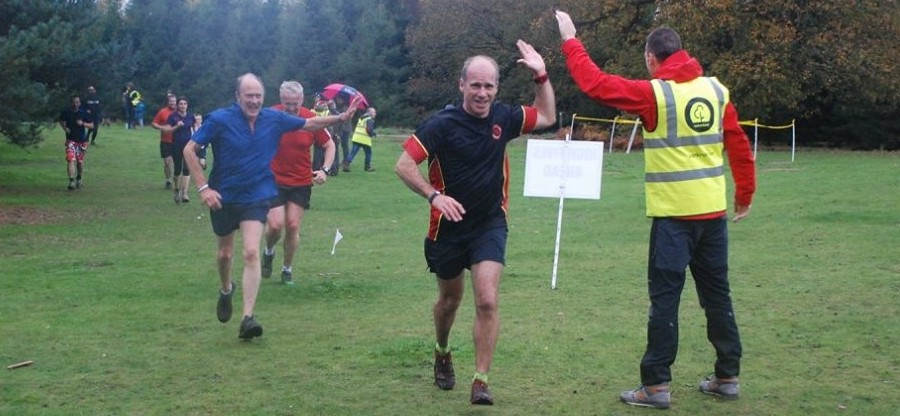 Andy Baddeley high five'ing runners at Rushmere parkrun