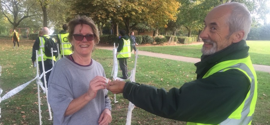 Chief Medical Officer Dame Sally Davies collecting her finish token at Finsbury parkrun