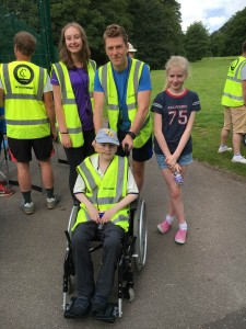 Adam with his cousin Emily and his uncle Martyn, both volunteers at junior parkrun, and his big sister Megan