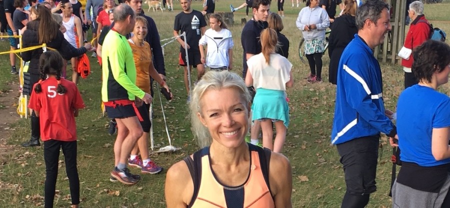 Nell McAndrew after completing her 50th parkrun, with the finish funnel in the background