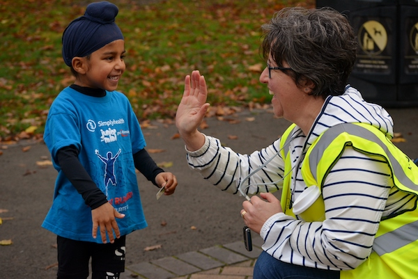 Our Youngest Runner Gets high 5 from Marshal