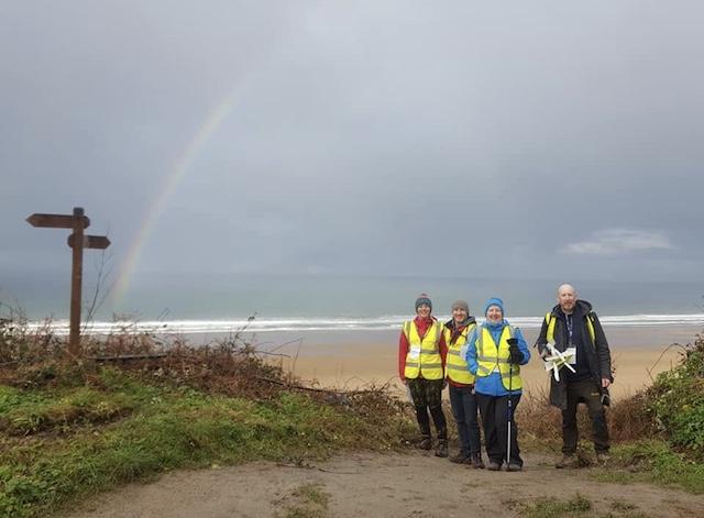 Volunteers and rainbow