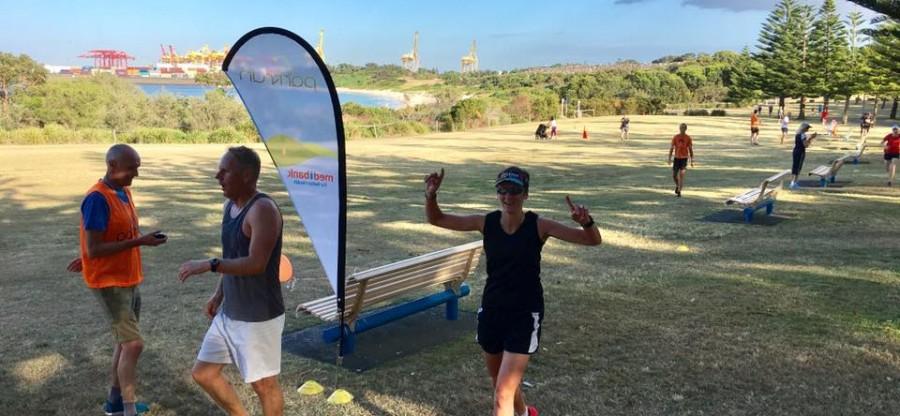 Nicola Woods finishing her 20th parkrun at Kamay
