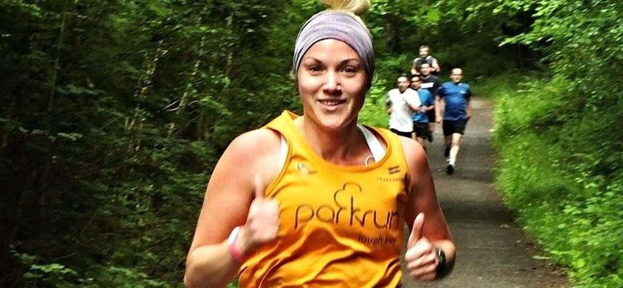 Melissa Doohan running in her apricot shirt