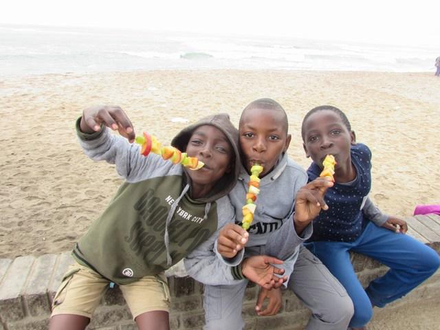 3 very happy MYO parkrunners with their fruit kebabs