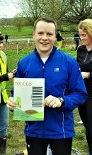 Gethin JONES becomes Guildford parkrun 100,000 finisher. See the massive finish token he earned!!