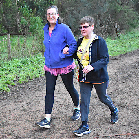 Wendy acting as a volunteer guide for vision-impaired parkrunner Sheilah.