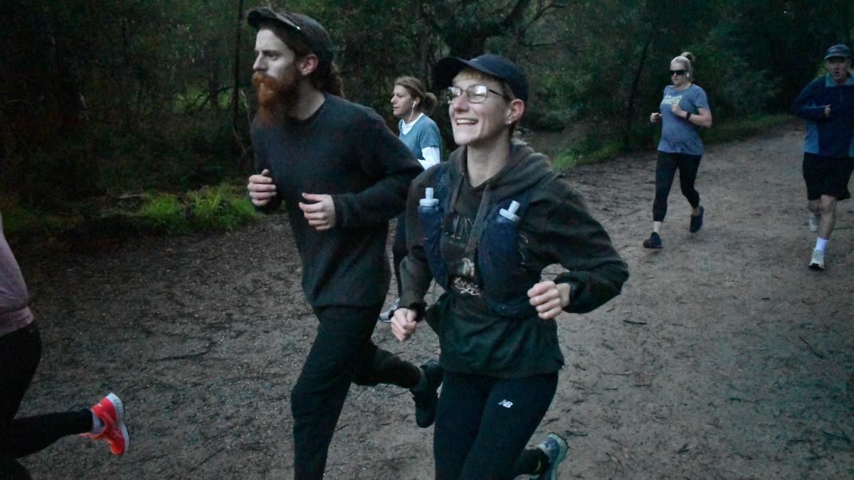 A man and a woman running beisde each other.