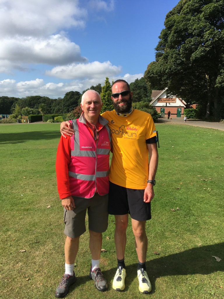 Richard Savoury, volunteering for the 25th time with his son, Adam.
