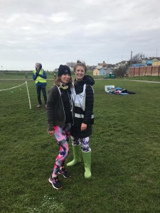 Carlyn and Livvy standing together to the side of the finish