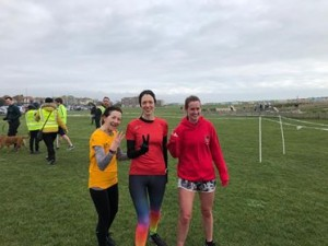 Samantha, Katie and Lisa showing 1, 2 and 3 with their fingers as they were the first three ladies to finish