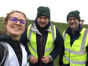 Livvy, Julian and Mike smiling in a seflie, wearing high vis jackets