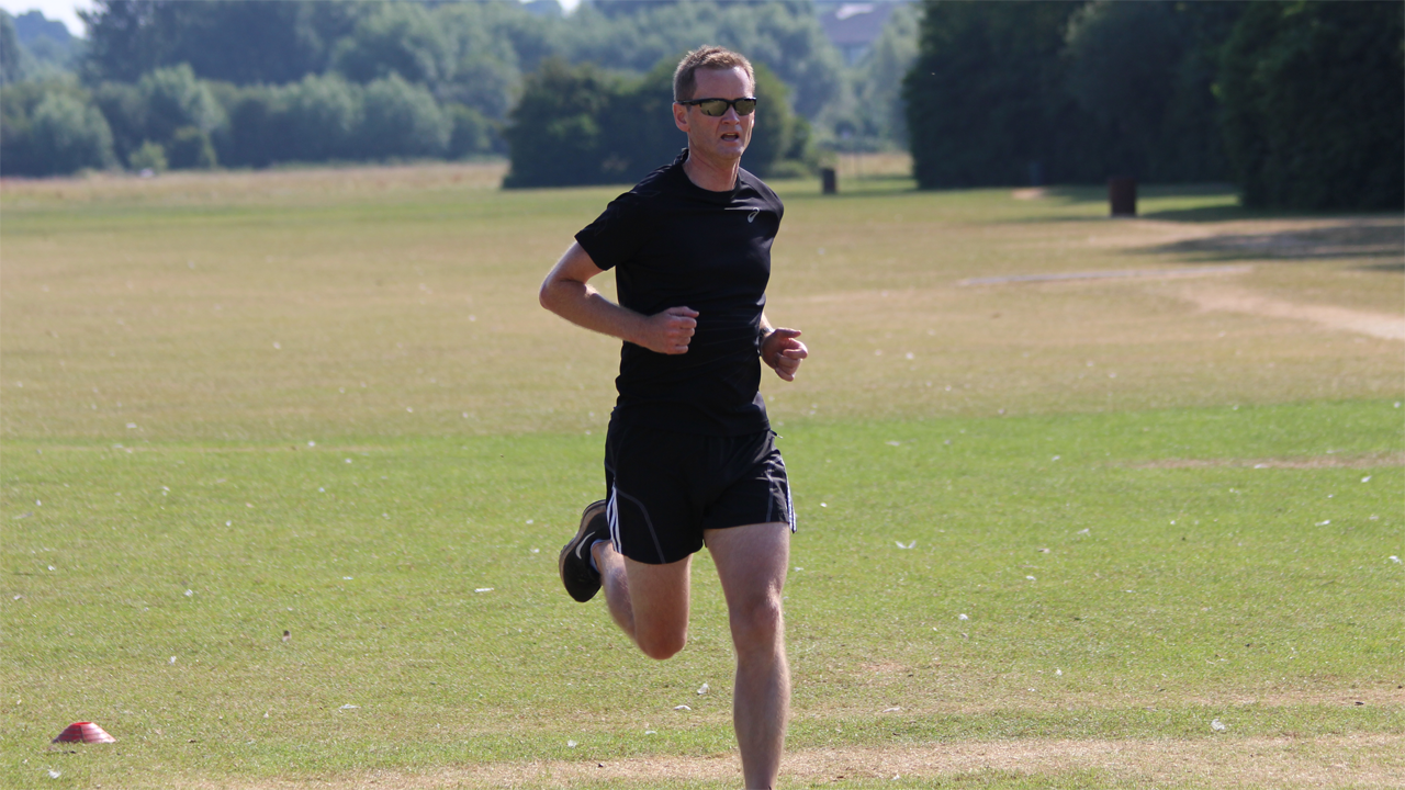Fergal runs towards the finish of Reading parkrun