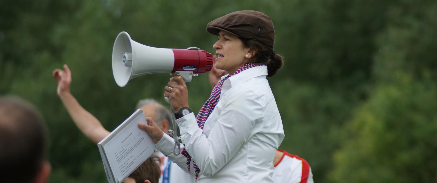 Teresa takes the run brief with a megaphone