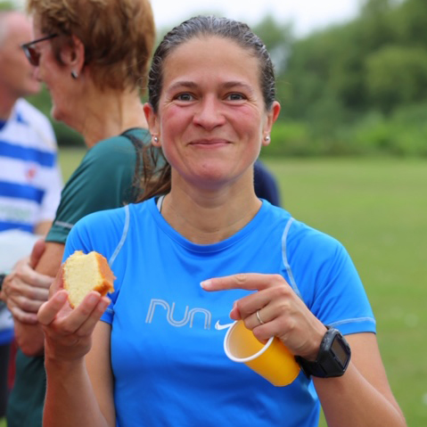 Teresa smiles after taking a mouthful of cake after a run