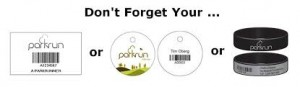 A photo showing parkrun printed personal barcodes on paper, plastic key tags and wrist bands.