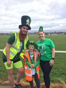 A man, woman and a child, in Irish themed outfits