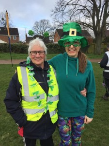 Two women with green Irish themed accessories