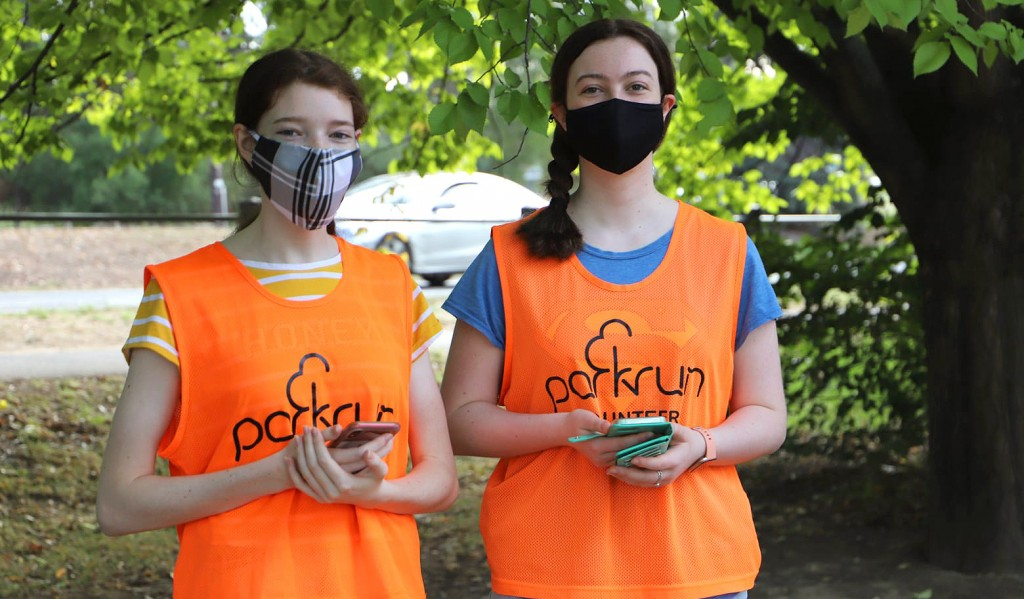 Two parkrun volunteers wearing facemasks