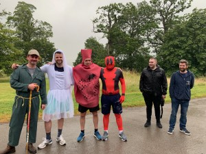 men dressed as bride, spiderman, whoopee cushion and sheperd