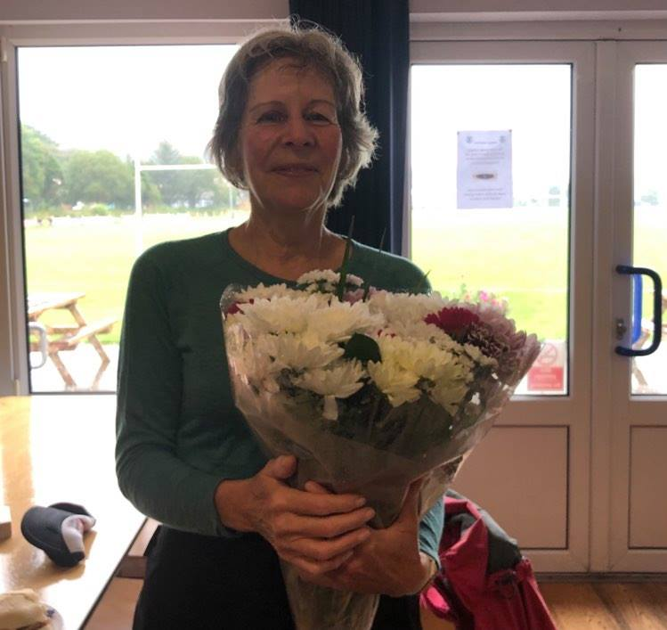 """Anita, our outgoing event director, with some flowers to say """"thanks""""."""