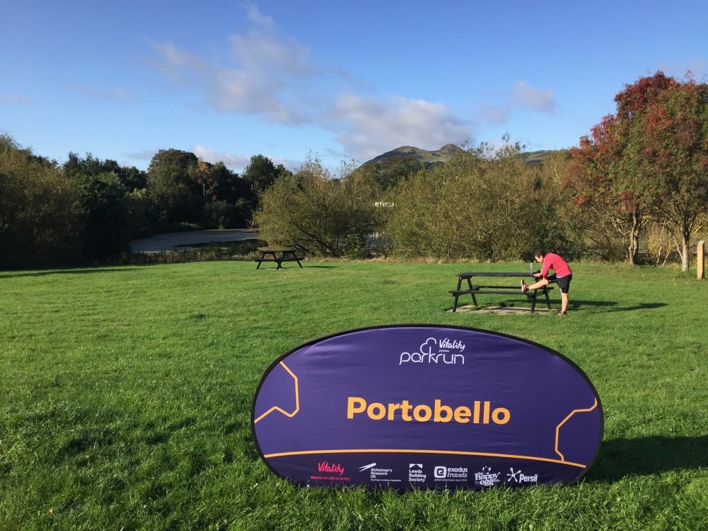 Portobello Parkrun start sign and vista to Arthur's Seat