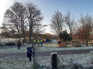 the volunteers and runners waiting for the start of the Parkrun on a very frosty morning
